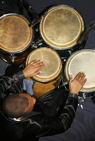 Various Latin artists playing different instuments on a band