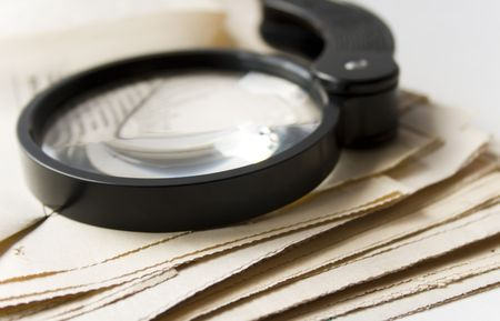 happenings: Magnifier and newspaper