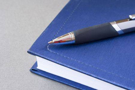 Organizer and pen on the grey background Stock Photo - 857092