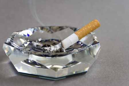 ashtray: Cigarette and ashtray isolated on grey Stock Photo