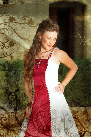 Beautiful smiling young bride in red and white dress with long curly hair standing outside in afternoon sun on grunge background photo