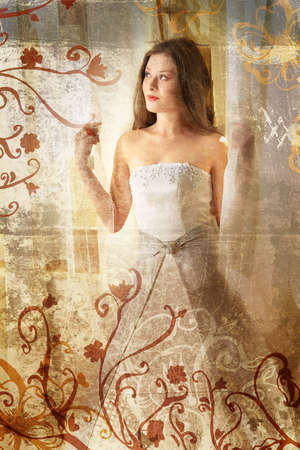Beautiful brunette bride with long hair on grunge background with swirls photo