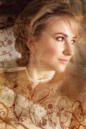 Beautiful blond bride with soft make-up on grunge background with rich texture and swirls and scrolls photo