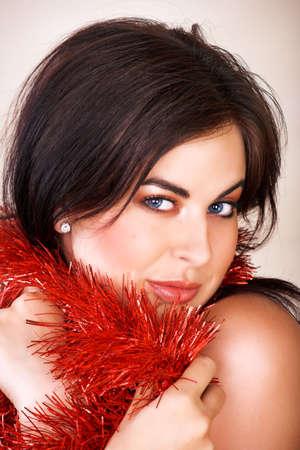 brown hair blue eyes: Beautiful woman with long brown hair, blue eyes with red shiny tinsel Stock Photo