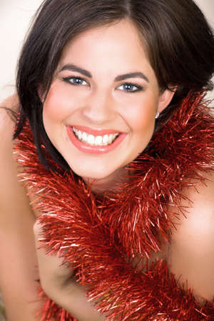 brown hair blue eyes: Beautiful woman with long brown hair, blue eyes with red shiny tinsel