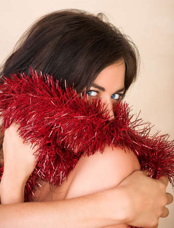 Beautiful woman with long brown hair, blue eyes and red tinsel Stock Photo - 2180165