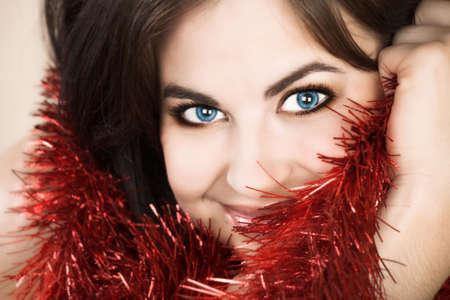 Beautiful woman with long brown hair, long hair and tinsel Stock Photo - 2180163