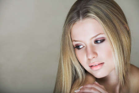 cute blonde: Young beautiful teenage girl with long blond hair and blue eyes in low key effect Stock Photo