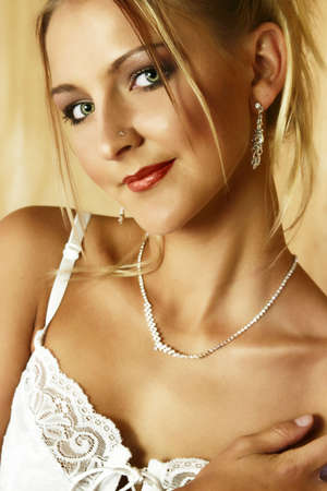 bedhead: Beautiful blond bride with large green eyes and diamante necklace in white lace bra