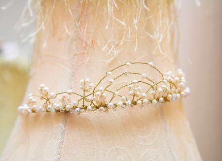 Wedding tiara made of delicate bronze wire and river pearls with crystals