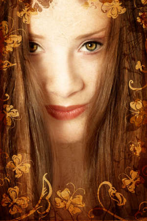 Brunette woman with long hair and green eyes on swirls and scrolls grunge swirls background with butterflies, paper grain photo