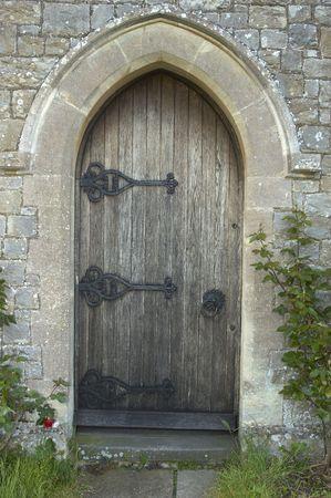 unyielding: Old church door Stock Photo