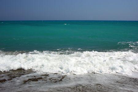 waves crashing: waves crashing on the shore Stock Photo