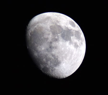 three phase: this is an image of the moon in three quarter phase. it was taken with a 2000mm lens.