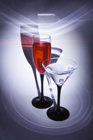 Two glasses with patches of light on a background