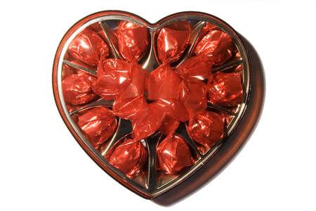 edibles: Casella in forma di cuore con cioccolatini caramelle  Archivio Fotografico
