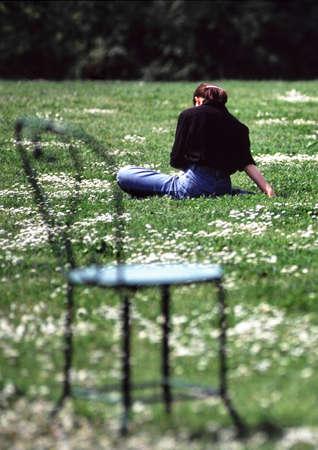 empty chair in a public garden Stock Photo