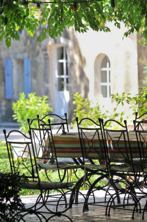 table and shade in Provencal house Stock Photo