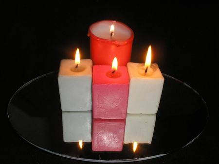 Candles aflame Stock Photo