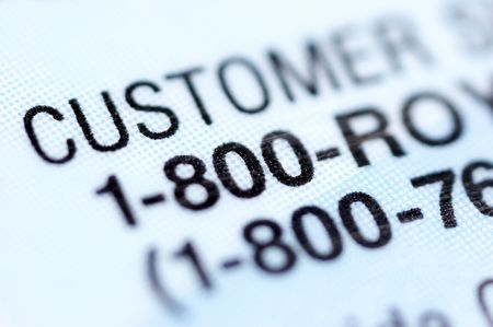 white backing: Customer service number. Part of credit card. Macro  Stock Photo