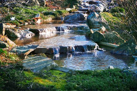cascade, stones, green grass  photo