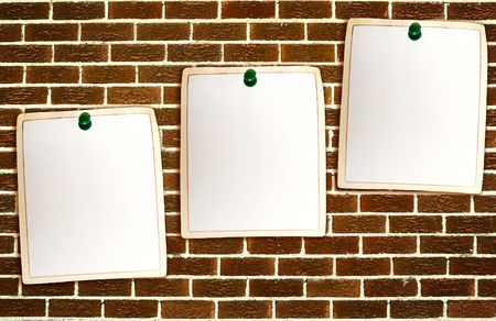 Clean paper sheets attached to the brickwall background