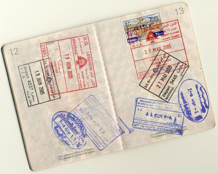 Page 12 an 13 from an isolated canadian passport fully stamped. All the stamps are either Lebanese Visas or Lebenese-Syrian border stamps. photo