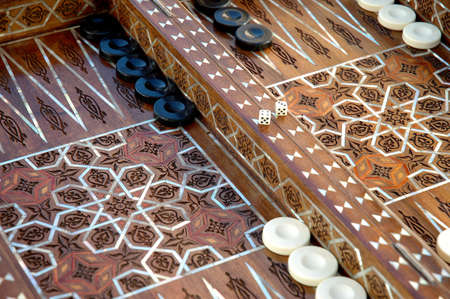 inlaid: Hand crafted syrian backgammon set composed on inlaid mother of pearl and precious woods.