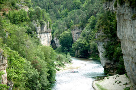 gorges: The Tarn river dominated by the spectacular cliffs of the Sauveterre and Mejean causses near La Malene in the Tarn Gorges. The gorges are very popular for canoe and kayak activities as well as for hiking and trekking - Department of Lozere, France
