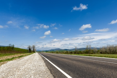 non marking: Highway under blue sky with clouds