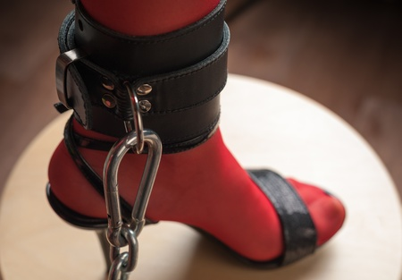 fetish wear: Chained Leg in Leather Cuff