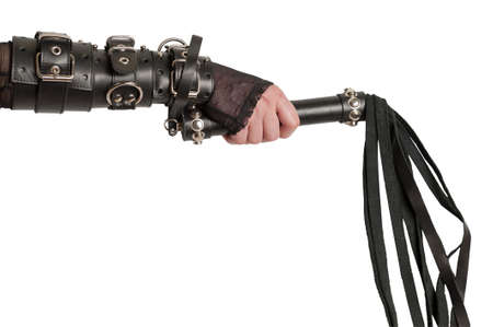 fetish wear: Hand in Leather Cuffs with Lash Isolated