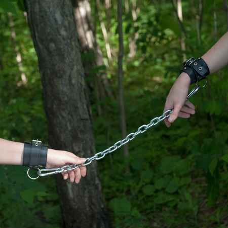 masochism: Women Hands Chained Forest Background