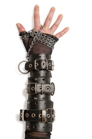Hand in Leather Cuffs Isolated photo