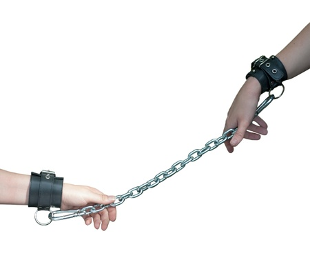 restraining device: Hands Chained on White.jpg