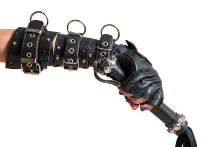 wrist cuffs: Hand in leather glove and lash