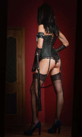 Mistress in Corset with Lash photo