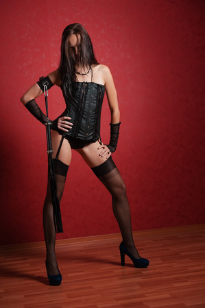 Young Mistress in Corset on Red photo