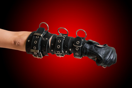 Fist in leather glove photo