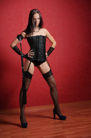 Young Mistress in Corset and with Lash photo
