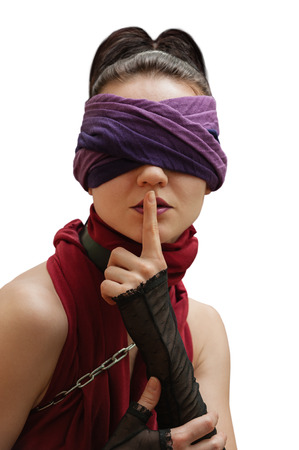 blindfolded: Blindfolded girl finger over lips white background Stock Photo