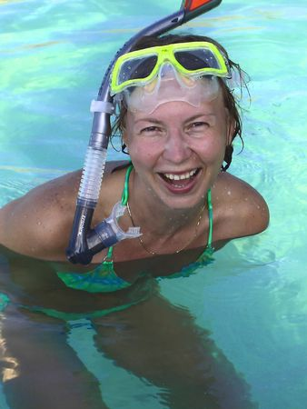 Happy woman in the ocean  occupied by snorkeling