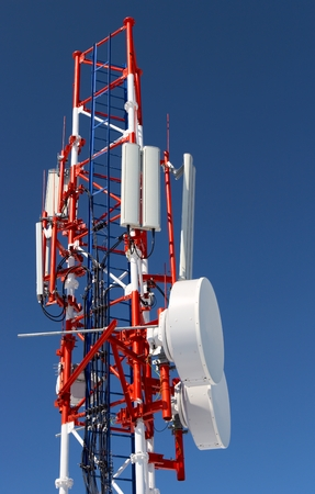 radio  cellular tower on a background of the blue sky photo
