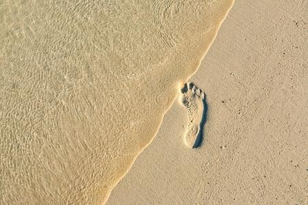 Fun footstep on a coral sandy beach photo