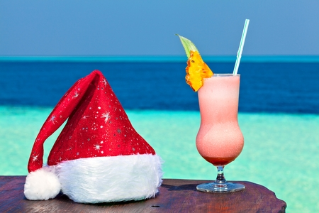 bocal: Bocal of drink is on a beach table with Santa hat (Maldives, The Indian Ocean)