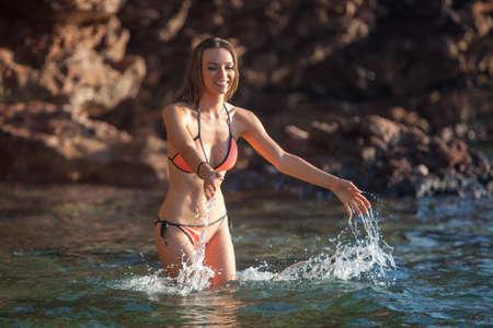splutter: Beautiful woman bathing at sea