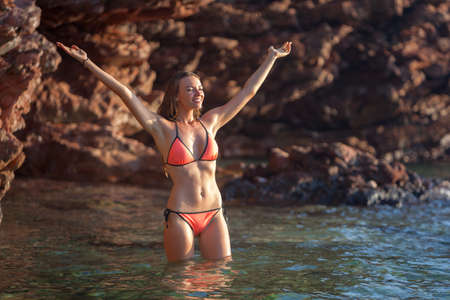 girl in nature: Beautiful woman bathing at sea