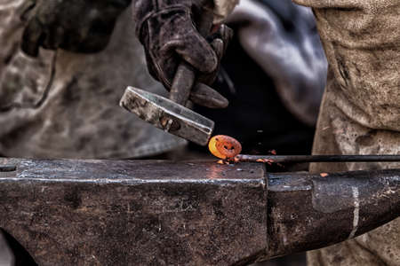 Detail shot of metal being worked at a blacksmith forge
