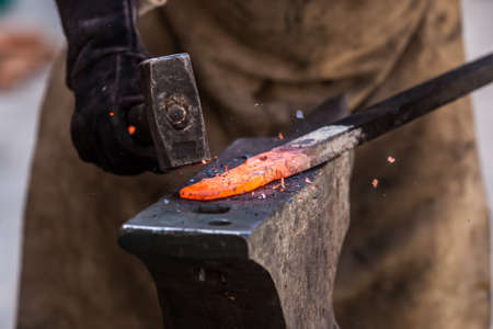 worked: Detail shot of metal being worked at a blacksmith forge