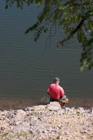 Man fishing on the banks of the Rhone river in France Stock Photo - 246478